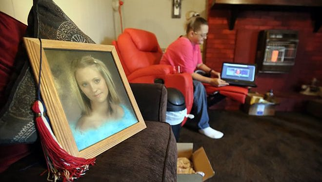 This 2015 photo shows Jessica Chambers' senior portrait and graduating tassel resting on the living room couch of her mother Lisa Chambers' Courtland, Miss. home.