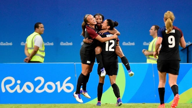 MANAUS, AMAZONAS - AUGUST 09: Crystal Dunn #16 of the United States celebrates with teammates after scoring against Colombia in the first half Women's Football First Round Group G match on Day 4 of the Rio 2016 Olympic Games at Amazonia Arena on August 9, 2016 in Rio de Janeiro, Brazil
