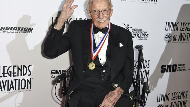"""In this Jan. 16, 2015, file photo, Bob Hoover attends the 12th annual Living Legends of Aviation Awards at The Beverly Hilton Hotel in Beverly Hills, Calif. Robert A. """"Bob"""" Hoover, a World War II fighter pilot who became an aviation legend for his skills in testing aircraft and demonstrating their capabilities in air shows, has died at age 94. Bill Fanning, a close family friend and a fellow pilot, says Hoover died early Tuesday, Oct. 25, 2016, in Southern California."""