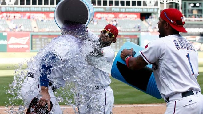 Joey Gallo is doused after driving in five runs in Texas' win Sunday against Oakland.
