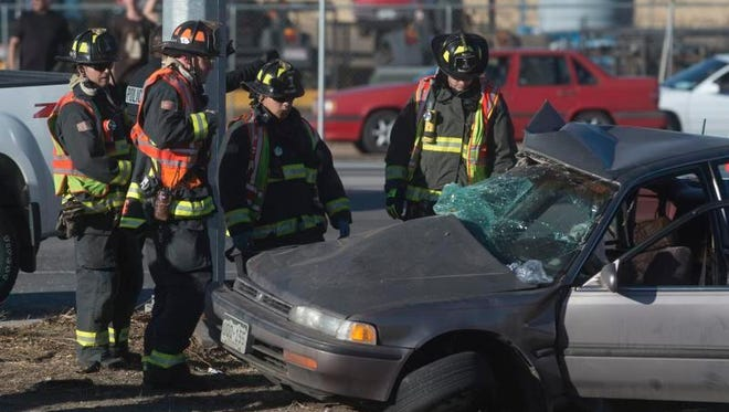 Firefighters respond to an approach turn crash at the intersection of Mulberry Street and the Interstate 25 frontage road Feb. 15. Approach turn, or left turn, crashes account for 14 percent of Fort Collins' serious crashes.