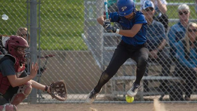 Poudre High School batter Shelby Hawkes jumps up as she is struck by a pitch during a game against Monarch on Tuesday,. Poudre won the game.