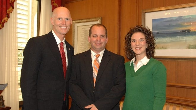 Tommy Hardee (center) appointed by Gov. Rick Scott in 2011 to Madison County Supervisor of Elections