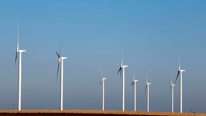 A group of wind turbines in rural Iowa.