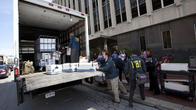 FBI agents load a truck full of boxes from the City-County Building's 20th-floor offices of the Indianapolis Department of Metropolitan Development on May 21, 2013. The FBI was investigating the Indy Land Bank.