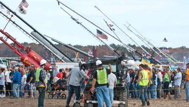 Film crews document the Punkin Chunkin competition in Bridgeville in 2013.