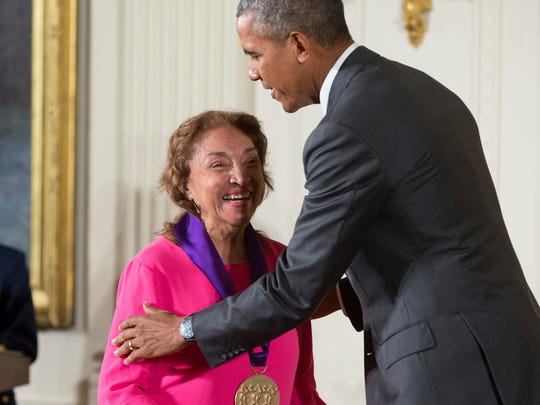 In this Sept. 10, 2015, photo, President Barack Obama awards the 2014 National Medal of Arts to actress, theater founder, and director Miriam Colon of New York during a ceremony in the East Room at the White House in Washington. Colon, an icon in U.S. Latino theater who starred in films alongside Marlon Brando and Al Pacino, has died at age 80. Her husband, Fred Valle, told The Associated Press that Colon died early Friday, March 3, 2017, because of complications from a pulmonary infection.