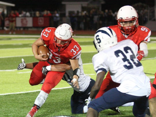 Port Clinton's Cooper Stine rushes against Sandusky