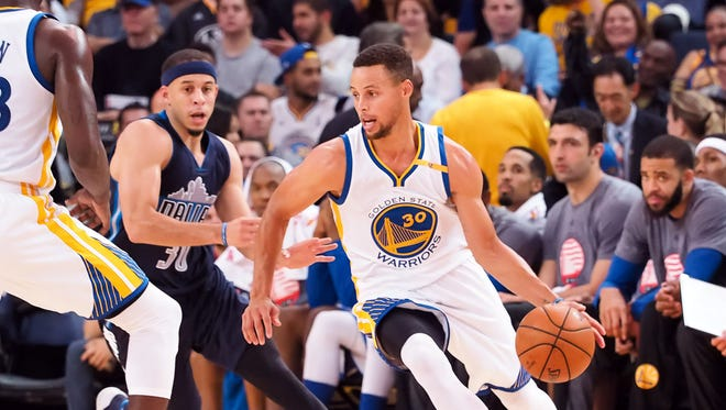 Nov 9, 2016; Oakland, CA, USA; Golden State Warriors guard Stephen Curry (30) drives in against Dallas Mavericks guard Seth Curry (30) during the second quarter at Oracle Arena. Mandatory Credit: Kelley L Cox-USA TODAY Sports