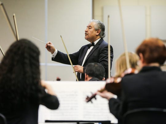 Hector Guzman directs San Angelo Symphony musicians during Friday's Youth Concerts at the McNease Convention Center.