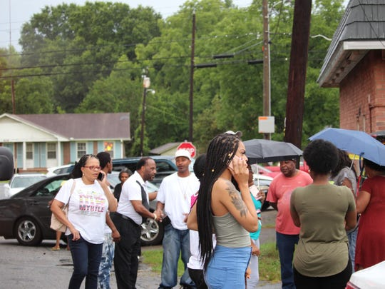Relatives and friends of Jesse Lee Alexander gathered on Richmond Avenue near Anderson on Tuesday night. Alexander's body was found behind a vacant building.