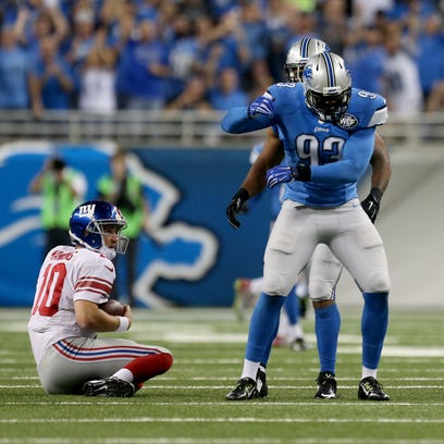 Detroit Lions defensive end George Johnson celebrates