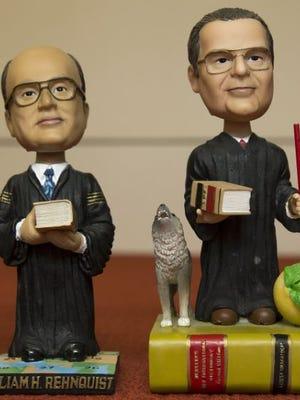 Bobbleheads representing late Supreme Court Justice William Rehnquist and late Justice Antonin Scalia.