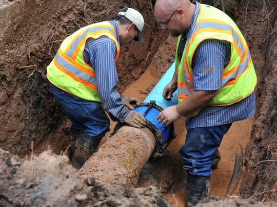 In this file photo, public works crews replace a 10-inch water main. During a four-year drought, the city had to hold off on regular water pipe replacement projects. Now that the drought is over and water revenue has improved, crews are hard at work again replacing old, leaky pipes throughout the city.