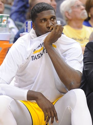 Roy Hibbert watches from the bench as the Pacers trail Atlanta by more than 30 points in the first half. The Indiana Pacers hosted the Atlanta Hawks in NBA action Sunday April 6, 2014 at Bankers Life Fieldhouse.