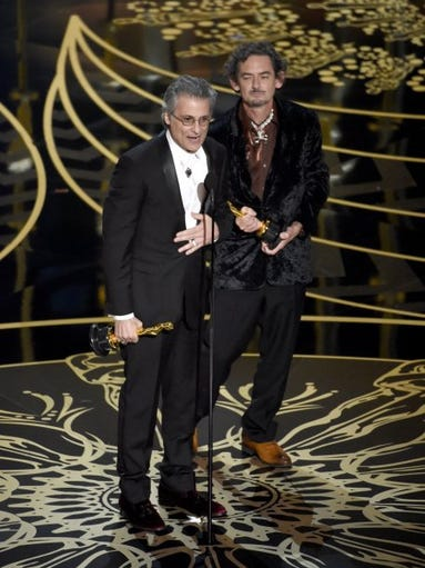 "Mark Mangini (left) and David White accept the award for best sound editing for ""Mad Max: Fury Road"" at the Oscars on Sunday, Feb. 28, 2016, at the Dolby Theatre in Los Angeles."