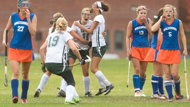 West Deptford's Jade Freeberg (No. 11, center) is mobbed by teammates, after Freeberg scored the game-winning goal in the second overtime period to give her team a 1-0 victory over Woodstown in the South Jersey Group 2 final last year.