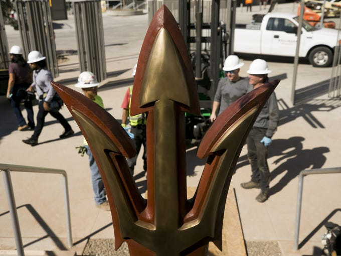 A bronze ASU pitchfork sculpture is installed In the