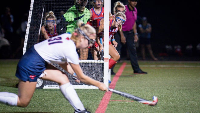 """Christian Academy of Louisville's defenders line up in the goal for Sacred Heart Academy corner shot a during the Championship Game of the 2017 Apple """"Stick it to Cancer"""" Field Hockey Tournament played in Louisville, Ky., Friday, August 25, 2017.  Christian Academy of Louisville defeated Sacred Heart Academy 3-2.  (Photo Bryan Woolston)"""