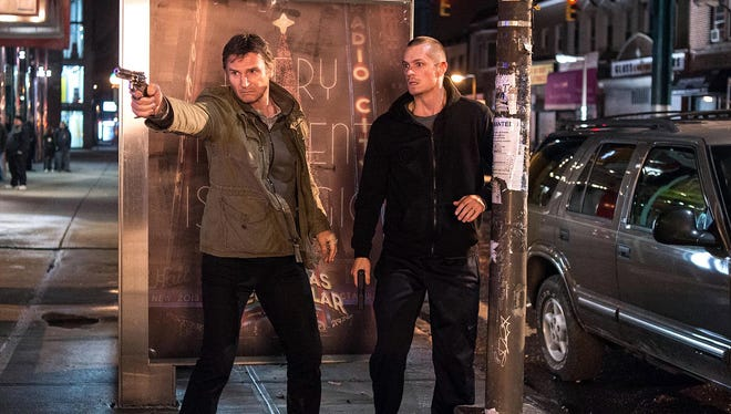 "Liam Neeson, left, as Jimmy Conlon and Joel Kinnaman as Mike in a scene from the motion picture ""Run All Night."""
