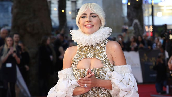 """Lady Gaga poses for photographers upon arrival at the premiere of her new film """"A Star Is Born"""" in London, Thursday."""