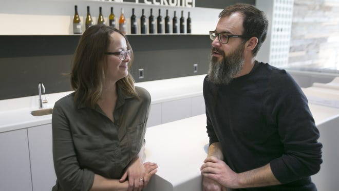 Rob and Sarah Hammelman of Wilcox, talk as they work on their new Sand-Reckoner Vineyards tasting room in Tucson.