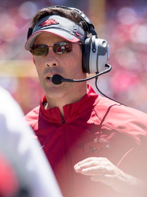 Arkansas offensive coordinator Dan Enos calls a play during the Razorbacks' spring game April 25, 2015, in Fayetteville, Ark.