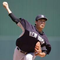New York Yankees starting pitcher Masahiro Tanaka delivers a pitch against the Minnesota Twins during the first inning of Tuesday's game.