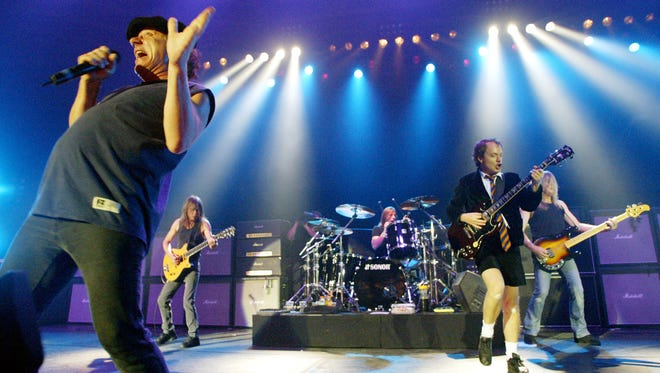 FILE - This June 17, 2003 file photo shows British rock band AC/DC, from left, Brian Johnson, Malcolm Young, Phil Rudd, Angus Young, and Cliff Williams performing on stage during a concert in Munich, southern Germany. The band says Young is not returning to the band after he announced he was taking a break from the group to focus on his health in April. A Wednesday statement from the band?s label said: ?Unfortunately, due to the nature of Malcolm's condition, he will not be returning to the band.? AC/DC will release the album ?Rock or Bust? on Dec. 2.