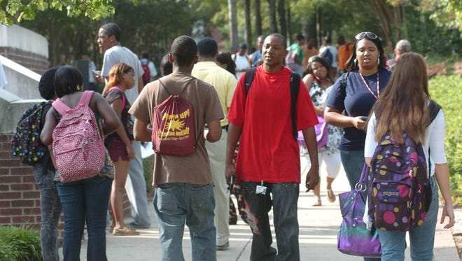 Hinds Community College students walk through The Courtyard while changing classes on Friday in Raymond.
