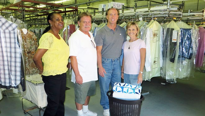 Helen Williams, Robbie McCollum, Jamie and Jone McCollum are part of the Village Cleaners family.