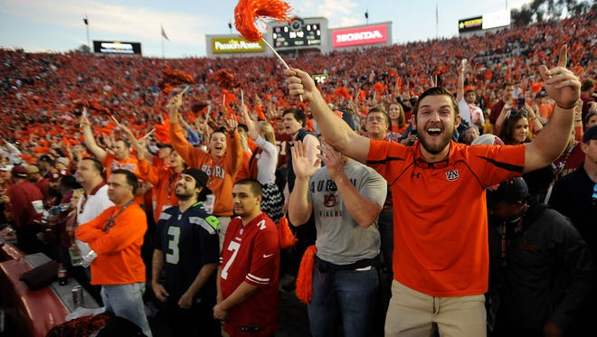 In this file photo, Auburn fans cheer before the BCS National Championship Game on Monday January 6, 2014 in Pasadena, Ca. (Mickey Welsh, Montgomery Advertiser)