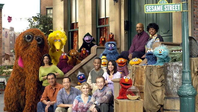 "The cast of ""Sesame Street"" poses in this undated publicity photo. ""Sesame Street Presents: The Street We Live On,'' a retrospective of the show as it enters its 35th season, airs on most PBS stations Sunday, April 4, 2004 at 8 p.m. EST, and also serves as the season opener the next day. (AP Photo/PBS, Richard Termine)"
