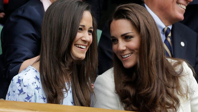 Duchess Kate and her sister Pippa Middleton are close, as here in royal box at Wimbledon in July 2012.