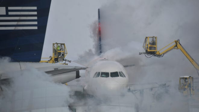 In this file photo from Jan. 6, 2014, a passenger jet is deiced at Indianapolis International Airport.