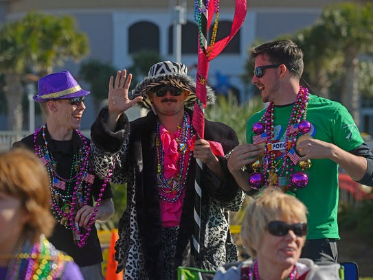 Revelers shout for beads Sunday during the Krewe of