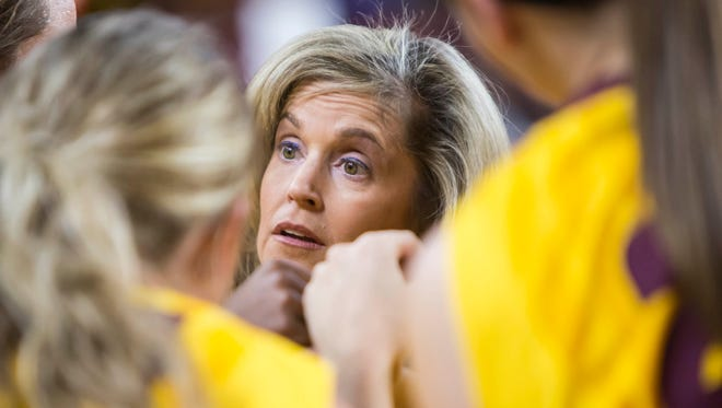 ASU women's head coach Charli Turner Thorne talks with the Gold team in the huddle during the Maroon and Gold Scrimmage on Friday, Nov. 7, 2014, at Wells Fargo Arena in Tempe, Ariz.