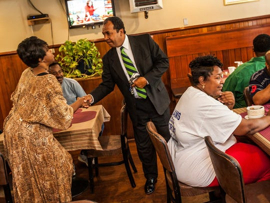 Dennis P. Williams is stopped as he leaves Evelyn's Soul Food restaurant after winning the 2012 Democratic primary