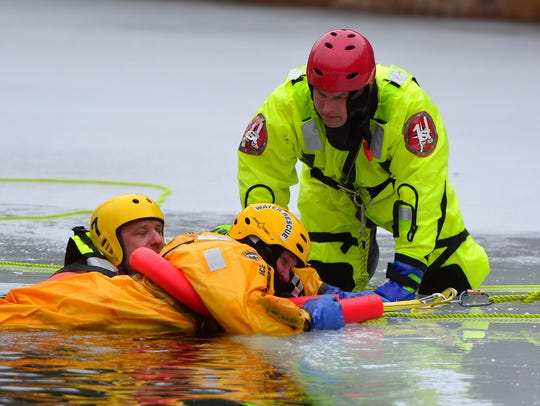 Instructor Alex Myers of Craley, right, watches closely