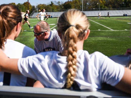 Elco head coach Derek Fulk talks to his players near