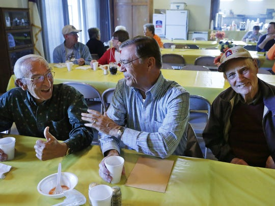 Having finished eating, Phil Birge, from left, George Newell and Leroy Good linger to talks with one another and other guests during a community breakfast Saturday, September 13, 2014, at Dayton Masonic Lodge 103, 773 Walnut Street  in Dayton. The lodge hosts a community breakfast the second Saturday each month.