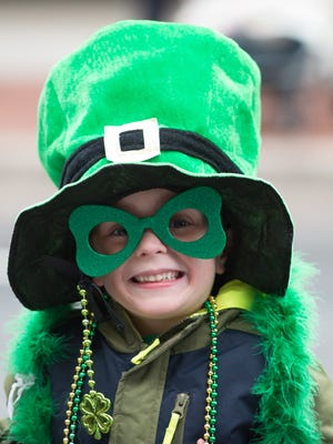 Michael Sharp, 5, of Wyoming poses for a photograph before the start of the 20th anniversary St. Patrick's Day Parade in downtown Dover.