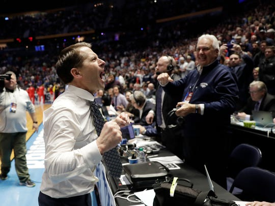 Nevada head coach Eric Musselman yells to the Wolf Pack cheering section, which included Ramon Sessions, after his team's win over Cincinnati on Sunday.