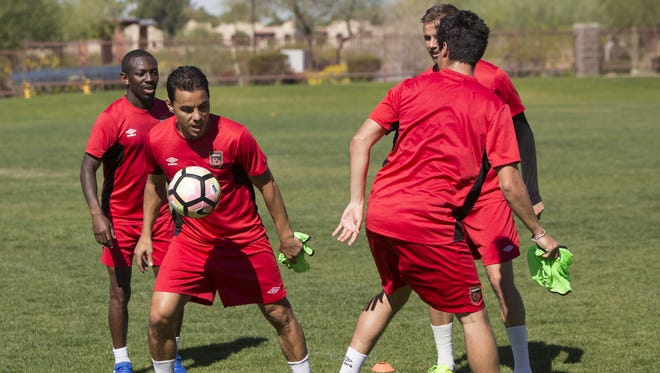 The Phoenix Rising FC soccer team practices at the Rancho Solano Preparatory school field in Scottsdale, Ariz. on Thur. March 16th, 2017.