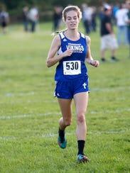 Winnebago Lutheran's Sarah Niehueser runs during a