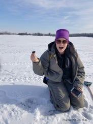 Ashley Moritz holds up a meteorite she found on a Hamburg