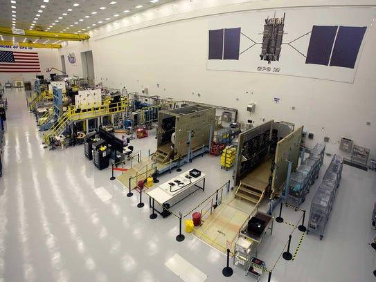 GPS III satellites in production flow at Lockheed Martin's