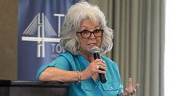 Celebrity chef Paula Deen speaks at Savannah?s Tourism Leadership Council luncheon Thursday, April 17, 2014, in Savannah, Ga., on her run in with her golden retriever-poodle pup ?Gus? that resulted in her walking boot with a broken foot. (AP Photo/The Savannah Morning News, Steve Bisson)