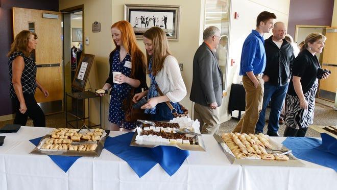 People mingle at the Academic All-Star reception Sunday at Chemeketa Eola's Northwest Wine Studies Center in West Salem.