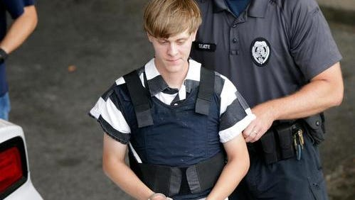 Dylann Storm Roof is escorted from the Cleveland County Courthouse in Shelby, N.C., on June 18, 2015. Roof is a suspect in the shooting of several people  at the historic The Emanuel African Methodist Episcopal Church in Charleston.